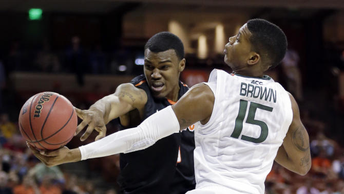 Miami's Rion Brown (15) and Pacific's Khalil Kelley go after a rebound during the first half of a second-round game of the NCAA college basketball tournament Friday, March 22, 2013, in Austin, Texas.  (AP Photo/Eric Gay)