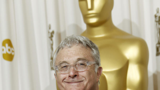 """FILE - This Feb. 27, 2011, file photo shows composer Randy Newman posing backstage with the Oscar for best original song  for """"We Belong Together"""" from """"Toy Story 3"""" at the 83rd Academy Awards in the Hollywood section of Los Angeles. Newman is weighing in on the presidential election, and he's playing the race card through a song he wrote. I'm Dreaming"""" is full of satirical, sarcastic _ and signature Newman _ anecdotes about someone who votes for the president because he is white. It features the refrain: """"I'm dreaming of a white president."""" Newman is openly supporting President Barack Obama. He says though the song is serious, he wants the public to find comedic relief in it. (AP Photo/Matt Sayles, File)"""