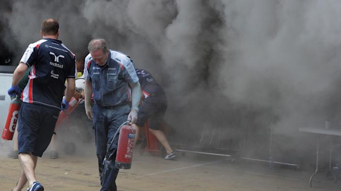 Racing team crews try to extinguish a fire in the Williams racing pit stand at the Circuit de Catalunya on May , 2012 in Montmelo on the outskirts of Barcelona after the Spanish Formula One Grand Prix.  AFP PHOTO / JOSEP LAGOJOSEP LAGO/AFP/GettyImages