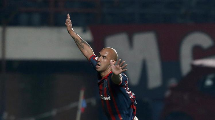 Mercier of San Lorenzo celebrates after scoring his team's third goal against Bolivar during their Copa Libertadores semi-final soccer match in Buenos Aires