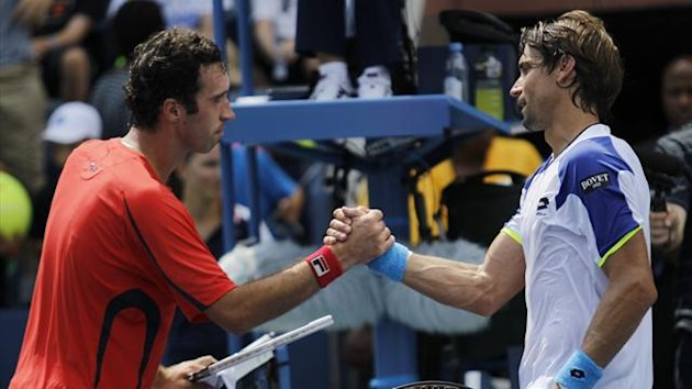David Ferrer of Spain (R) is congratulated by Mikhail Kukushkin of Kazakhstan after his victory at the U.S. Open tennis championships in New York August 31, 2013 (Reuters)
