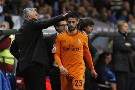 Real Madrid's Isco is congratulated by his coach Carlo Ancelotti after he was substituted during their Spanish First Division soccer match against Malaga in Malaga