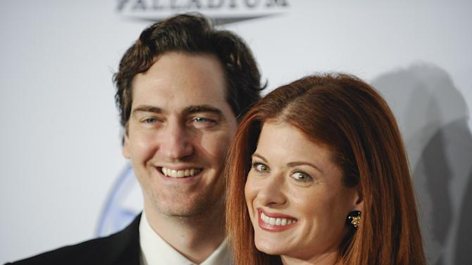 FILE - In this Saturday, Jan. 24, 2009 file photo, producer Daniel Zelman and wife actress Debra Messing, right, arrive at the 20th Annual Producers Guild Awards, in Los Angeles. Messing filed for divorce from Zelman on Tuesday June 5, 2012 in Los Angeles, citing irreconcilable differences. The pair, who have an 8-year-old son, were married in September 2000 but separated in early 2010. (AP Photo/Gus Ruelas, File)