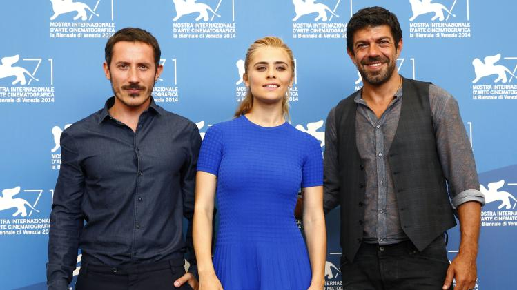 "Director Alhaique poses with cast members Favino and Scarano during the photo call for the movie ""Senza nessuna pieta"" at the 71st Venice Film Festival"