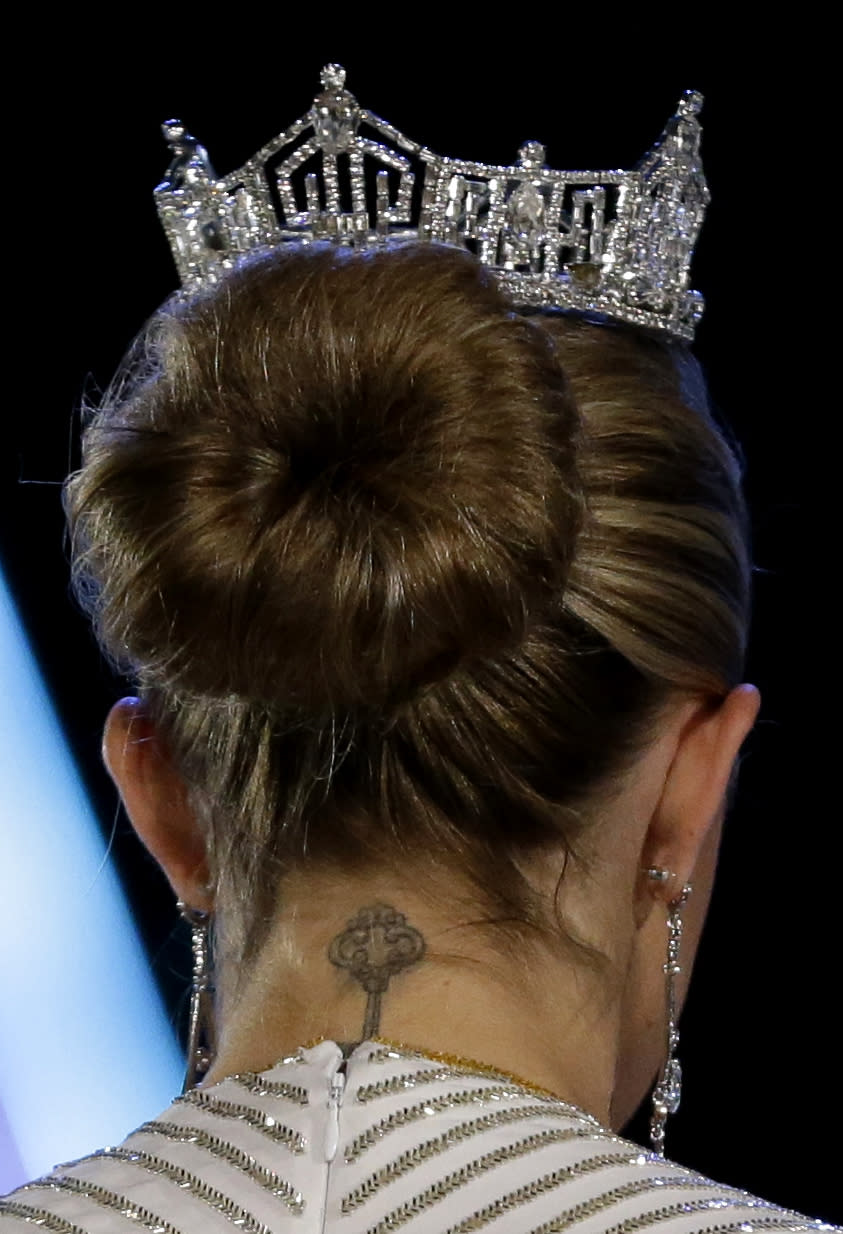 A tattoo is seen on the neck of Miss America 2013 Mallory Hagan during the Miss America 2014 pageant, Sunday, Sept. 15, 2013, in Atlantic City, N.J. (AP Photo/Julio Cortez)