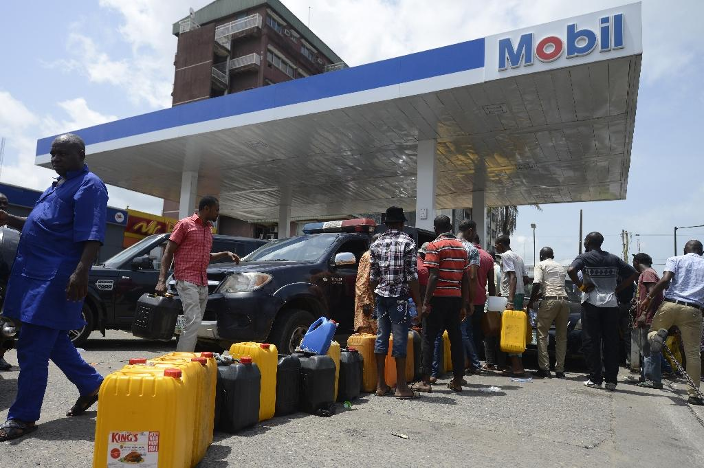 Nigerians groan under biting petrol shortages over subsidy row