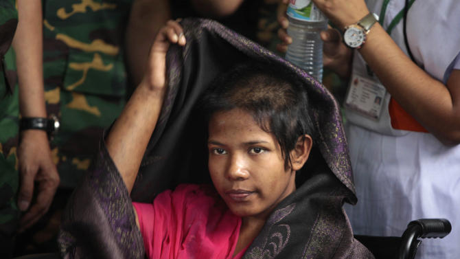 Reshma Begum, the 19-year-old seamstress who spent 17 days trapped in the rubble of a collapsed factory building, adjusts her shawl as she meets the media at a hospital in Savar, near Dhaka, Bangladesh, Monday, May 13, 2013. Begum said Monday that she will never again work in a Bangladesh garment factory.  Nearly three weeks after the Bangladesh garment-factory building collapsed, the search for the dead ended Monday at the site of the worst disaster in the history of the global garment industry. The death toll: 1,127. (AP Photo/A.M. Ahad)