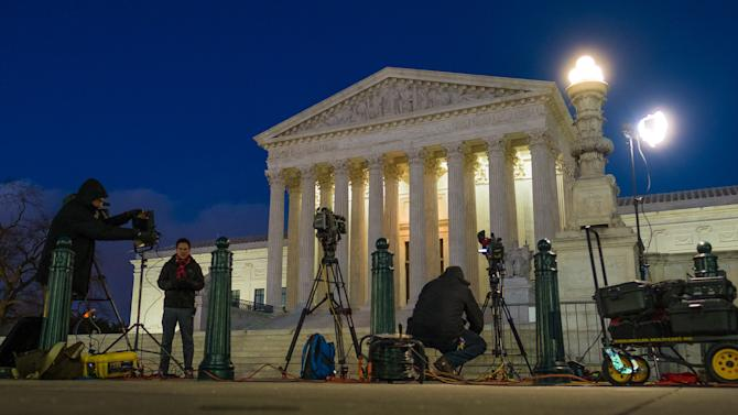 Television news crews set up in front of the U.S. Supreme Court building in Washington, Saturday, Feb. 13, 2016. On Saturday, the U.S. Marshals Service confirmed that Justice Antonin Scalia has died at the age of 79. (AP Photo/J. David Ake)