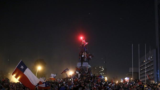 Fans celebrate on the street after their national soccer team beat Argentina in their Copa America final soccer match in Santiago, Chile