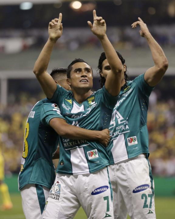 Edwin Hernandez of Leon celebrates with team mates after scoring against America during the second leg of the Mexican league championship final soccer match at the Azteca stadium in Mexico City