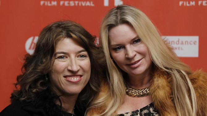 """FILE - In this Jan. 19, 2012 file photo, filmmaker Lauren Greenfield, left, and documentary subject Jacqueline Siegel, pose together at the opening night premiere of """"The Queen of Versailles"""" at the 2012 Sundance Film Festival in Park City, Utah. (AP Photo/Danny Moloshok, File)"""