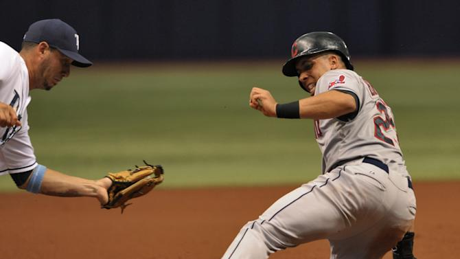Cleveland Indians' Michael Brantley, right, slides into third base ahead of the tag from Tampa Bay Rays' Asdrubal Cabrera, left, during the first inning of a baseball game Monday, June 29, 2015, in St. Petersburg, Fla. (AP Photo/Steve Nesius)