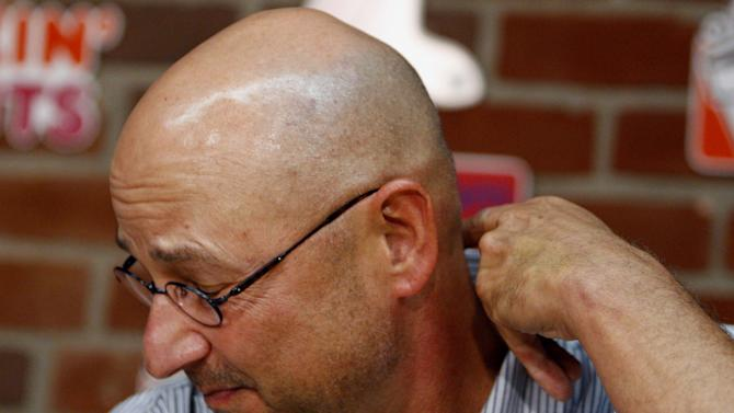 Former Boston Red Sox manager Terry Francona pauses as he addresses the media during a news conference, Friday, Sept. 30, 2011, in Boston. In a joint statement released on Friday, the Red Sox announced they will not pick up the option on Francona's contract for a ninth year in the wake of the team's September collapse in which they blew a nine-game lead in the American League wild-card race. (AP Photo/Bizuayehu Tesfaye)