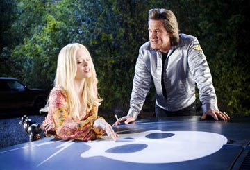 "Rose McGowan and Kurt Russell in the ""Death Proof"" segment of Dimension Films' Grindhouse"
