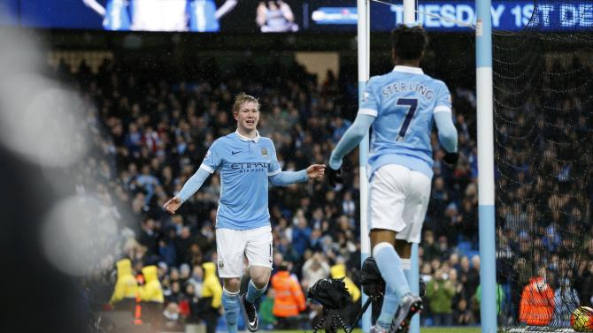 Kevin De Bruyne celebrates with Raheem Sterling after scoring the first goal for Manchester City