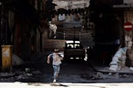 &lt;p&gt;A young boy runs across the street during clashes between Free Syrian Army fighters and forces loyal to President Bashar al-Assad in Syria&#39;s northern city of Aleppo, on August 24. Mohamed Morsi, the first Egyptian leader to set foot in Iran in decades, caused a storm Thursday when he slammed the Syrian regime as &quot;oppressive&quot; and urged backing for rebels out to topple President Bashar al-Assad.&lt;/p&gt;
