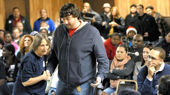 Community activist Lisa Fithian, left, teaches SEIU (Service Employees International Union) Healthcare Michigan member Frank Shaft, 26, of Lansing, and other attendees how to peacefully interact with police officers on Saturday, Dec. 8, 2012 at UAW Local 600 union hall in Dearborn, Mich.  Republican lawmakers are putting the final touches on legislation that would allow workers to opt out of union dues at a business where employees are represented by a union. Gov. Rick Snyder says he will sign it into law. (AP Photo/Detroit News, Todd McInturf)  DETROIT FREE PRESS OUT; HUFFINGTON POST OUT