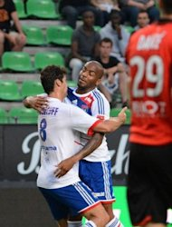 Lyon&#39;s French midfielder Yoann Gourcuff (L) celebrates with his teammate Jimmy Briand after scoring during their French L1 football match against Rennes at the route de Lorient stadium in Rennes, western France. Lyon won 1-0