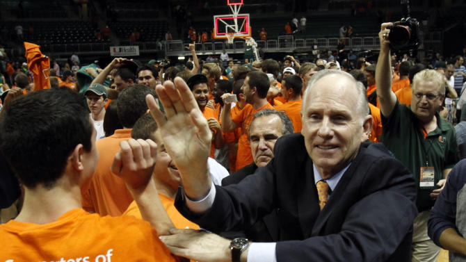 FILE - In this Nov. 28, 2012, file photo, Miami's head coach Jim Larranaga, right, is congratulated by fans after their 67-59 win over Michigan State in an NCAA college basketball game in Coral Gables, Fla. Larranaga has received a three-year extension from the Hurricanes, who now have him under contract for the next nine seasons. (AP Photo/Alan Diaz, File)
