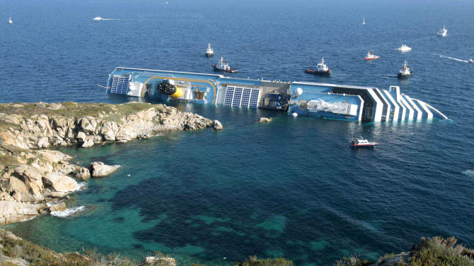 FILE - In this Jan. 14, 2012 file photo the luxury cruise ship Costa Concordia leans on its side after running aground in the tiny Tuscan island of Giglio, Italy. Italian authorities say the bold operation to set the Concordia cruise ship upright is set for next week, 20 months after the ship capsized near a tiny Tuscan island, killing 32 people. The national Civil Protection agency chief, Franco Gabrielli, told islanders on Giglio island Wednesday that crews could try to set the shipwreck upright as soon as Sept. 16. He stressed that the exact date for the operation will only be known the day before, since the final OK depends upon weather and sea condition forecasts. (AP Photo/Gregorio Borgia, Files)