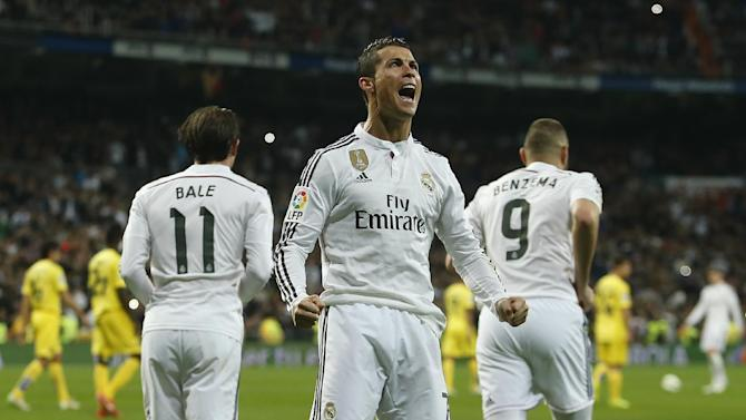Real Madrid's Cristiano Ronaldo, centre, celebrates his goal during a Spanish La Liga soccer match between Real Madrid and Villarreal at the Santiago Bernabeu stadium in Madrid, Spain, Sunday, March 1, 2015. (AP Photo/Andres Kudacki)