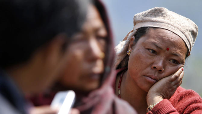 A relative of a missing person mourns at the scene of a flash flood at Kharapani village of Kaski district, about 200 kilometers (125 miles) west of Katmandu, Nepal, Sunday, May 6, 2012. Flash floods from the Seti river in western Nepal swept away dozens of people along with their cattle and houses, officials said. Bodies have been recovered, a police official said.(AP Photo/Niranjan Shrestha)