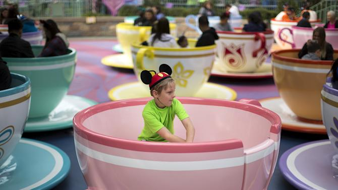 "A boy rides the ""Mad Tea Party"" during Disneyland's Diamond Celebration in Anaheim"