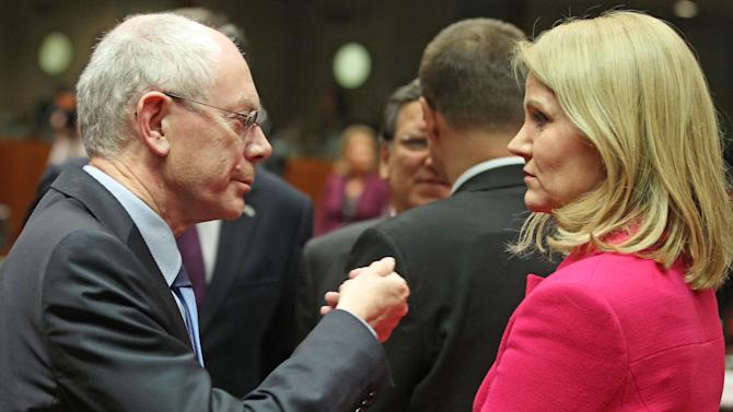Denmark's Prime Minister Helle Thorning-Schmidt, right, talks with European Council President Herman Van Rompuy, during the EU Budget summit at the European Council building in Brussels, Thursday, Feb. 7, 2013. European Union leaders drew hard lines Thursday ahead of a struggle over EU spending for the next seven years that reflects deep divisions about the role of their union. (AP Photo/Yves Logghe)