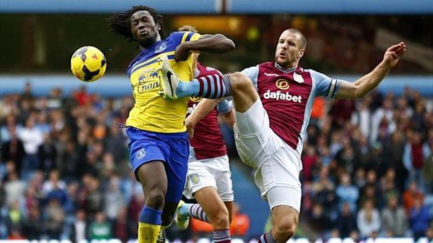 Aston Villa's Ron Vlaar challenges Romelu Lukaku of Everton (Reuters)