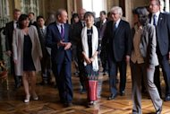 Paris Mayor Bertrand Delanoe (2nd L) welcomes Myanmar pro-democracy leader Aung San Suu Kyi (C) at the Paris City Hall. Suu Kyi, nearing the end of her triumphant Europe tour in France, accepted another award today as she became an honorary citizen of Paris