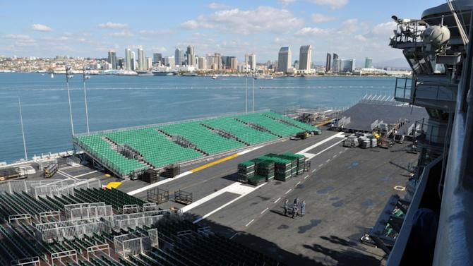 In this image provided by the U.S. Navy bleachers are set-up on the flight deck of the aircraft carrier USS Carl Vinson Monday Nov. 7, 2011 for the Quicken Loans Carrier Classic basketball game. The Michigan State University Spartans are playing the University of North Carolina Tar Heels aboard Carl Vinson for the first ever Quicken Loans Carrier Classic on Veteran's Day, Nov. 11, 2011. (AP Photo/U.S. Navy - Seaman Amanda Huntoon)