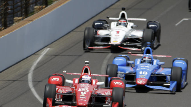 Simon Pagenaud, of France, leads, Scott Dixon, of New Zealand, (9), Tony Kanaan, of Brazil, (10) and Will Power, of Australia, (1) during the 99th running of the Indianapolis 500 auto race at Indianapolis Motor Speedway in Indianapolis, Sunday, May 24, 2015.  (AP Photo/AJ Mast)