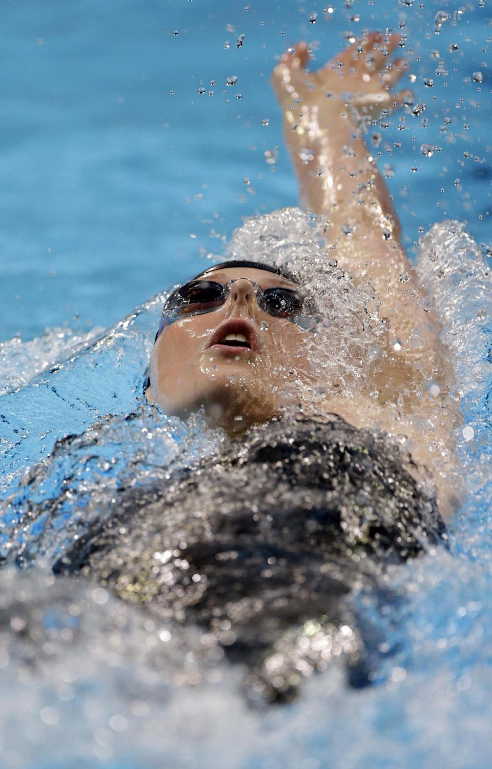 Missy Franklin swims in the women's 200-meter backstroke final at the U.S. Olympic swimming trials on Saturday, June 30, 2012, in Omaha, Neb. (AP Photo/Mark Humphrey)