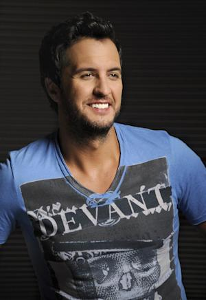 In this Tuesday, July 16, 2013 photo, Luke Bryan poses for a portrait at Audio Productions in Nashville, Tenn. Bryan has taken an unusual approach to the business side of his career since winning the Academy of Country Music's entertainer of the year in April: He's turning down almost everything. (Photo by Donn Jones/Invision/AP)
