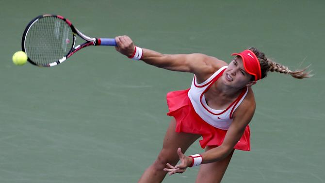 Bouchard of Canada serves to Hercog of Slovenia during their match at the U.S. Open Championships tennis tournament in New York