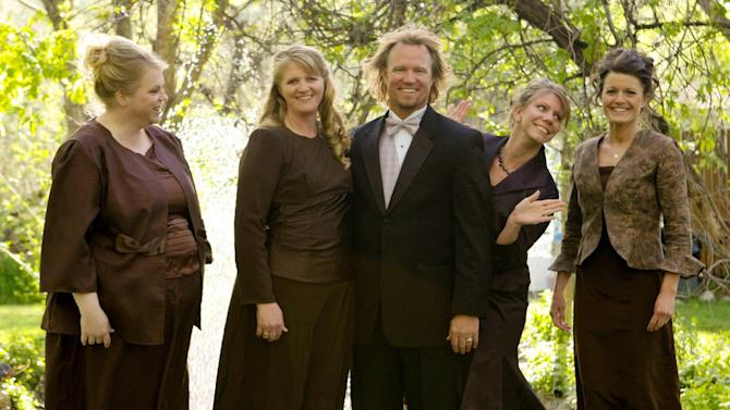 "FILE - In this undated file photo provided by TLC, Kody Brown, center, poses with his wives, from left, Janelle, Christine, Meri, and Robyn in a promotional photo for TLC's reality TV show, ""Sister Wives.""  A Utah county attorney says he will not pursue criminal charges against this polygamous family made famous by a reality TV show. Utah County Attorney Jeff Buhman says he has closed the case against Brown and his four wives. (AP Photo/TLC, Bryant Livingston, File)"