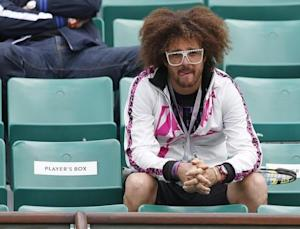Redfoo of LMFAO watches as his girlfriend Azarenka of Belarus plays Schiavone of Italy during the French Open tennis tournament in Paris