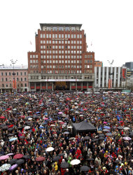 "Some 40,000 people stand in drizzling rain in Youngstorget square, Oslo, Norway Thursday April 26, 2012 to participate in the singing of ""Barn av Regnbuen"" (Children of the Rainbow). The song which was a hit of Norwegian folk singer Lillebjoern Nilsen several decades ago, has become a signature tune for the victims of the July 22, 2011 bombing and shooting massacre that killed 77 people as survivors gave tearful testimony Thursday in the trial of mass killer Anders Behring Breivik. (AP Photo/Kyrre Lien/NTB Scanpix) NORWAY OUT"