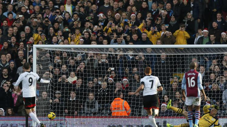 Fulham's Berbatov shoots to score a penalty during their English Premier League soccer match against Aston Villa in London