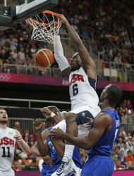 USA's Lebron James dunks during the first half of a preliminary men's basketball game against France at the 2012 Summer Olympics, Sunday, July 29, 2012, in London. (AP Photo/Charles Krupa)