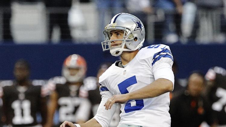 Dallas Cowboys kicker Dan Bailey (5) follows through on a field goal under pressure from Cleveland Browns wide receiver Josh Cribbs (16) late in the second half of an NFL football game, Sunday, Nov. 18, 2012, in Arlington, Texas. (AP Photo/Brandon Wade)