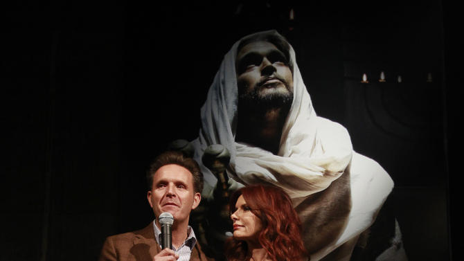 Producer Mark Burnett and producer and actress Roma Downey speaks to guest at the celebration of theApril 2Blu-ray, DVD, and Digital HD releaseof THE BIBLEfrom Twentieth Century Fox Home Entertainment  during The Bible Experience opening night gala, a rare exhibit of biblical artifacts on Tuesday, March 19 in New York. (Photo by Mark Von Holden/Invision for Fox Home Entertainment/AP Images)
