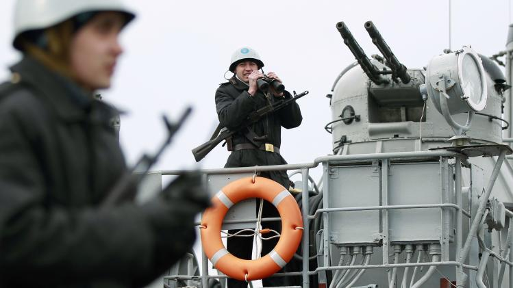 Ukrainian sailors stand guard on top of the Ukrainian navy ship at the Crimean port of Yevpatorya
