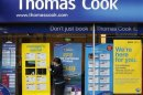 A worker changes the window display of Thomas Cook in Loughborough