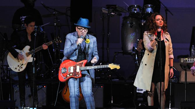 """Musician Elvis Costello, left, performs with Maya Rudolph at """"The Music of Prince"""" tribute concert at Carnegie Hall on Thursday March 7, 2013 in New York. (Photo by Evan Agostini/Invision/AP)"""