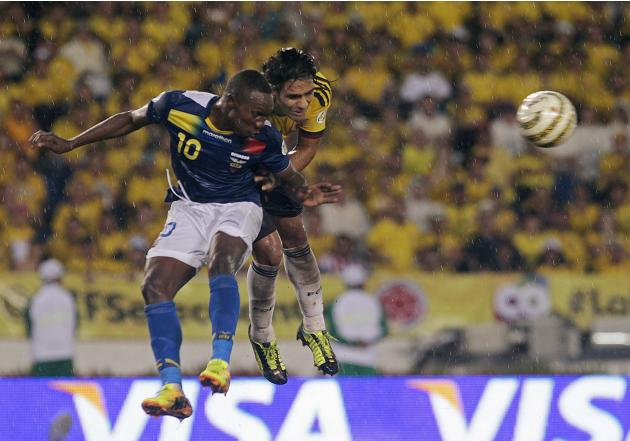 Colombia's Abel Aguilar battles Ecuador's Walter Ayovi for the ball during their 2014 World Cup qualifying soccer match in Barranquilla