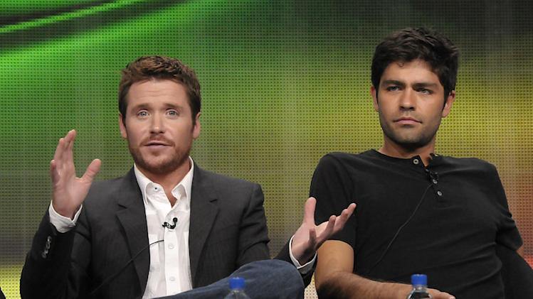 """FILE - In this July 28, 2011 file photo, actor Kevin Connolly, left, and actor Adrian Grenier speak during The Television Critics Association 2011 Summer Press Tour in Beverly Hills, Calif. Grenier and Connolly star in the series """"Entourage"""" on HBO. Warner Bros. confirmed Wednesday, Jan. 30, 2013, that a film version of HBO's hit series """"Entourage"""" is in the works. (AP Photo/Dan Steinberg, File)"""