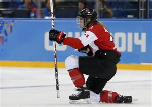 Canada's Meghan Agosta-Marciano celebrates her goal against Finland during the third period of their women's ice hockey game at the Sochi 2014 Sochi Winter Olympics