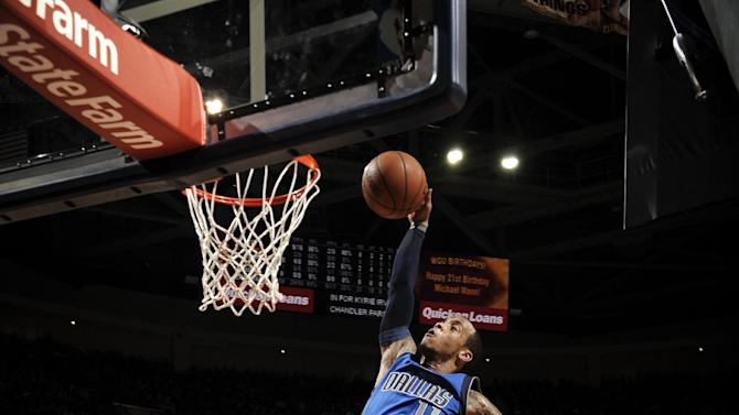 Ellis scores 20 points, Mavs beat Cavs 109-90