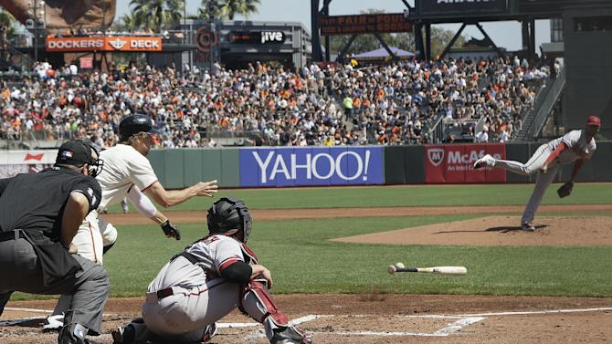 Peavy strikes out 8, pitches Giants past D-backs